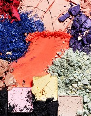 Crushed multi-colored powdered eyeshadow and cracked cosmetics