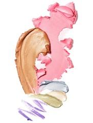 Smeared bronzer and pastel cream eyeshadow against white background