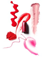 Lipstick, drizzled red liquid cosmetics and smeared pink makeup