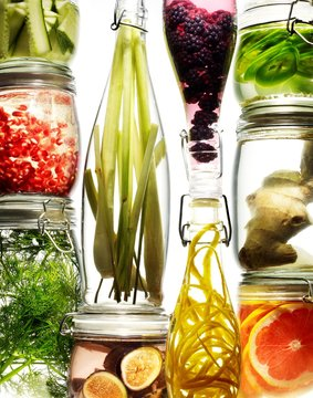 Glass jars of fruits slices and vegetables