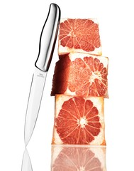 Stack of sliced grapefruit cubes with silver knife