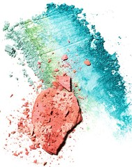Powdered pink blush and turquoise blue eyeshadow against white background