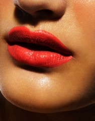 Close up of woman's lips with red lipstick