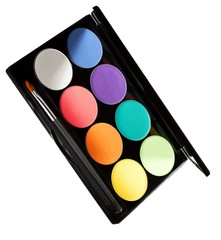 Palette case of eyeshadows and cosmetics brush against white background