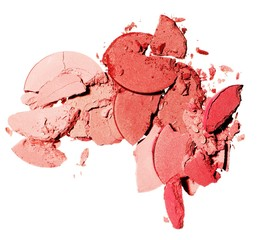 Close-up of red and pink crushed powdered cosmetics against white background