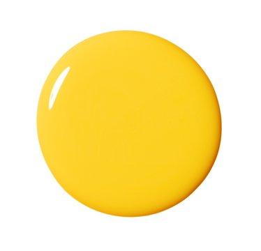 Close up circle of shiny yellow liquid cosmetics