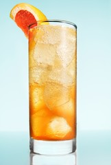 Tall glass of cold drink with grapefruit slice