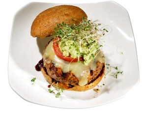 Chicken patty burger topped with alfalfa sprouts bun