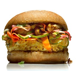 Close up of egg burger bun with vegetable slices