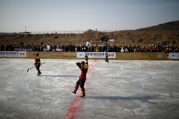 A Canadian soldier celebrates after team scored a goal against South Korean team in a friendly Ice Hockey Game during the Imjin Classic 2018 near the demilitarised zone separating the two Koreas in Paju
