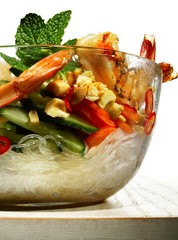 Glass bowl of noodles with prawns, shrimp and vegetables