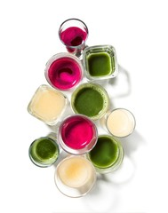 Top view of glasses of fruit juices and smoothies
