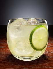 Glass of alcohol with lime slice
