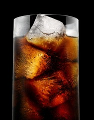 Low angle view of glass of cola with ice cubes