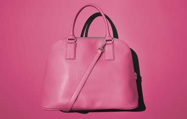 Pink purse on pink background
