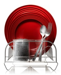 Clean plate, fork and spoon in dish rack with steel wool sponge