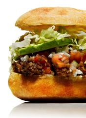 Close up sandwich with ground beef and avocado