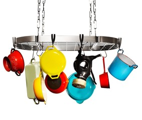 Saucepans, colander, skillets and gas mask hanging metal ceiling rack
