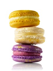 Three yellow and purple macaroons