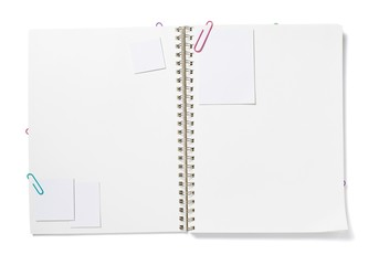 Blank white notepad paper with paper clips in spiral bound notebook