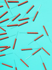 Pile of acupuncture needles against blue background