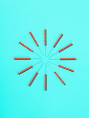 Circle of acupuncture needles against blue background