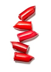 Pieces of red lipstick stacked