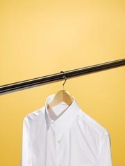 White button-down shirt on hanger