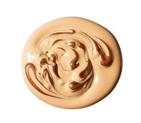 Swirled beige and brown creamy liquid cosmetic foundation