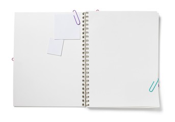 Blank pages in spiral bound notepad with paper clips