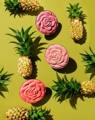Pineapples and rose shaped powdered blush yellow background
