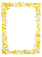 Frame outline of yellow vitamins and pill tablets