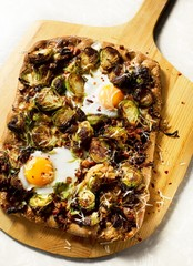 Grilled flatbread with eggs, cheese and brussel sprouts