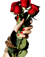 Women with red fingernails and bracelets holding red roses