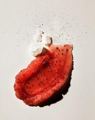 Smeared strawberry exfoliating skin scrub