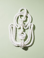 Knotted white rope shaped like an anchor