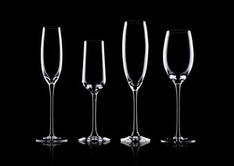 Empty champagne glasses on black background