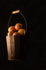 oranges in a wooden basket