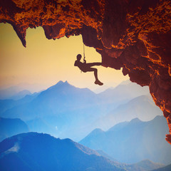 Climber on a rocky cliff