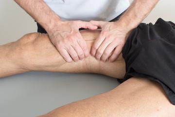 Massage therapist giving a leg massage