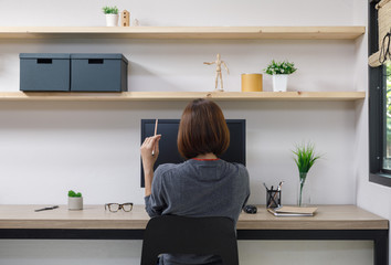 Young woman freelancer with computer in room area, Woman working at the desk, Freelance artist