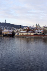 Snowy Prague Lesser Town with St. Nicholas' Cathedral, Czech republic