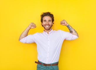 Cheerful man showing muscles
