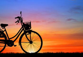 silhouette vintage bike on sunrise.