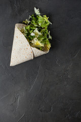Lavash with herbs with olive oil and spices on a dark background