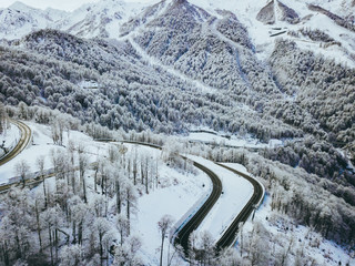 aerial view of the road in the winter mountain forest