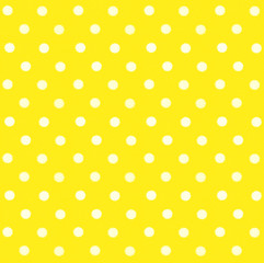 White polka dots on yellow textile background