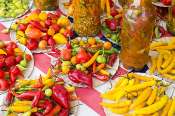 Brightly colored fresh and preserved chili peppers on display at the tropical farmers market in the Ipanema neighborhood in Rio de Janeiro, Brazil