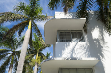 Detail of classic Art Deco architecture with palm trees and blue sky in South Beach, Miami, Florida