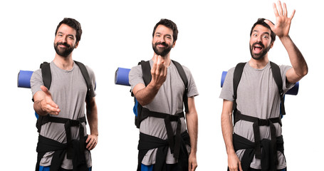 Set of Handsome backpacker doing coming gesture